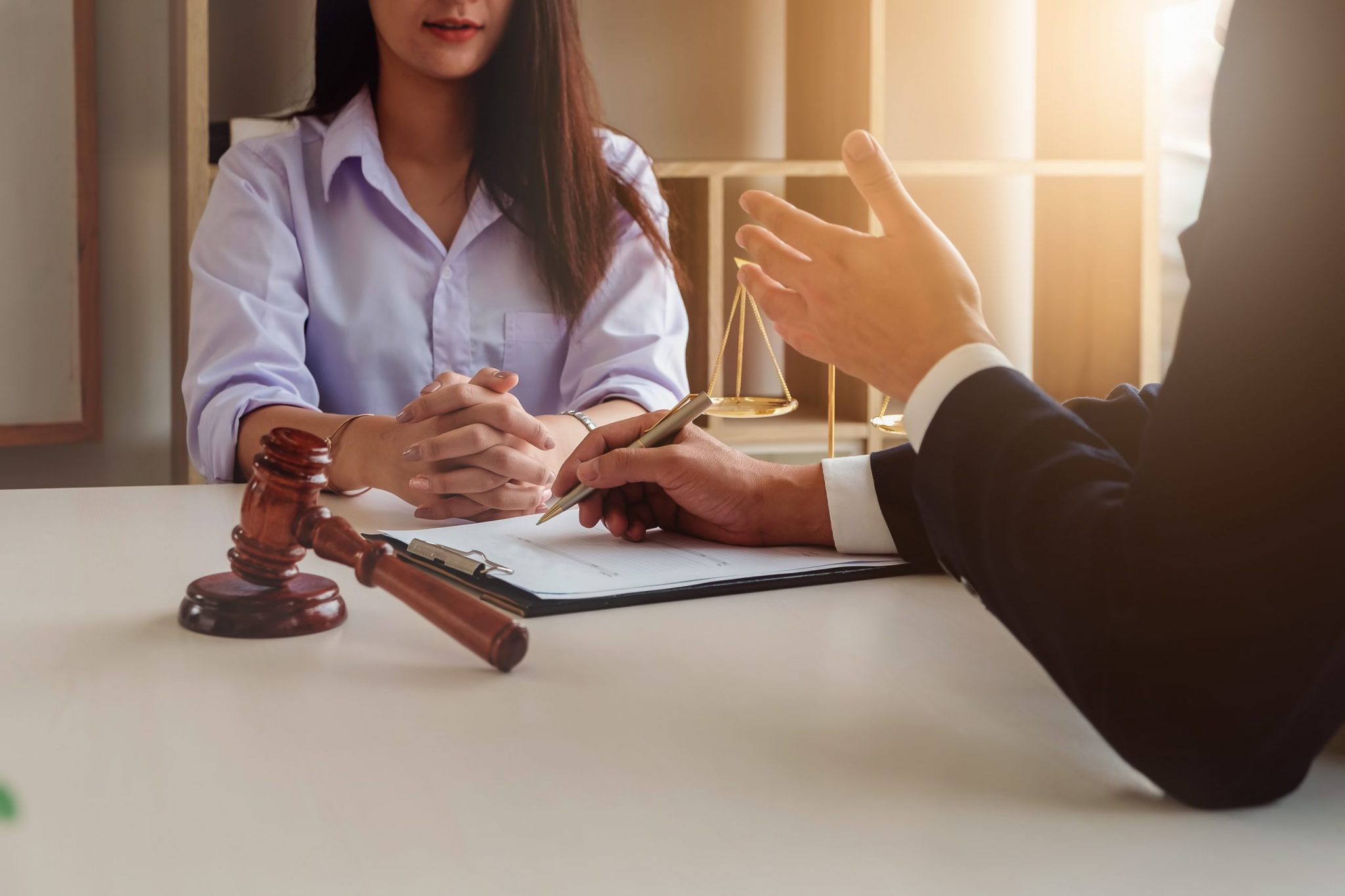 Law should know concept, The lawyer explained to the client to plan the case in court.